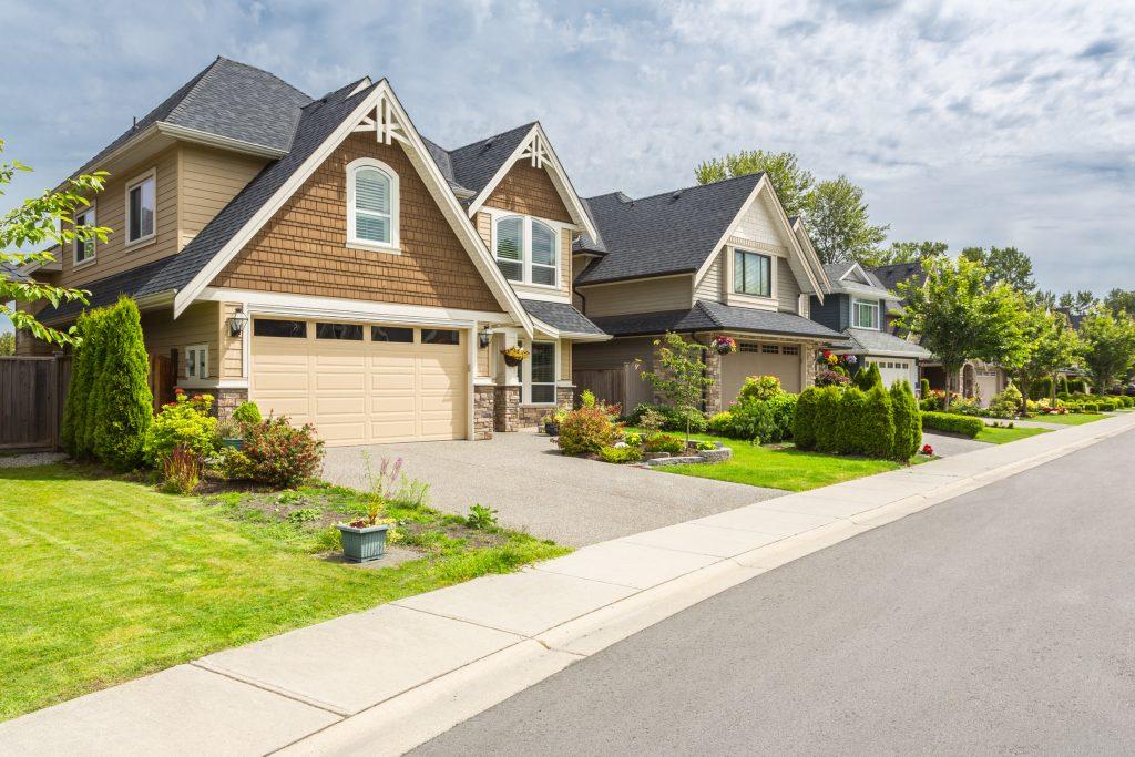 A well-manicured suburban neighborhood of houses.