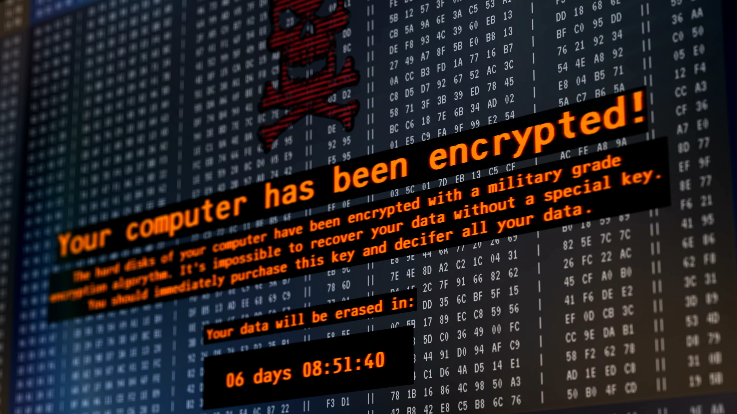 """Malware warning message with headline """"Your computer has been encrypted!"""" displayed on a computer screen."""